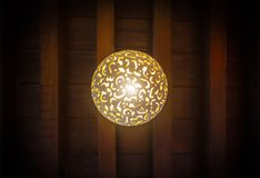 Lamp in the Arab style. The lamp in the Arab style hangs on the ceiling of a dark room royalty free stock photo