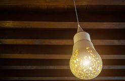 Lamp in the Arab style. The lamp in the Arab style hangs on the ceiling of a dark room stock images