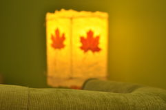 Lamp, artistic product in the living room, an evening with a glass. Royalty Free Stock Image
