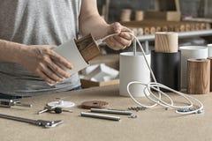 Lamp assembling in workshop Royalty Free Stock Photos