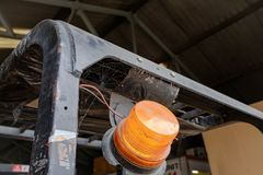 Improvised warning beacon seen attached to a forklift truck in a warehouse. royalty free stock photos