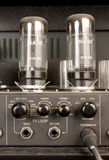 Lamp audio signal amplifier. Proffessional lamp audio amplifier with knobs and plugged jack Stock Image