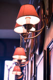 Lamp in a bar. A close-up of one of three lamps in a french bar/bistro stock image