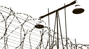 Lamp and barbed wire Stock Image