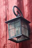 Lamp on barn. Outside lamp against barn board Royalty Free Stock Image