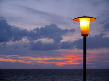 Lamp on the beach in sunset Stock Images