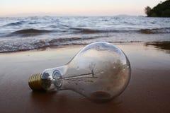 Lamp on the beach. Unplug lighting on the beach royalty free stock photo