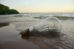 Lamp on the beach. Unplug lighting on the beach stock photos