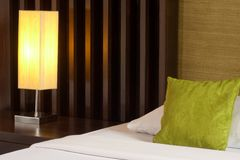 Lamp and bed Stock Photography
