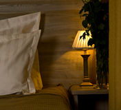 Lamp on bedroom nightstand Royalty Free Stock Images