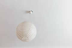 Lamp in the bedroom. A symbol of decoration, simplicity, lighting Royalty Free Stock Photography