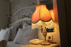 Lamp on bedside table Royalty Free Stock Image