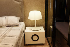 Lamp on bedside table in bedroom Stock Photography