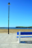 The lamp and the bench. Sunny evening in Kilkee County Clare, Ireland Royalty Free Stock Photos