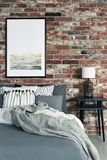 Red brick wall in bedroom royalty free stock photography