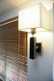 Lamp and blinds. Wall mounted lamp with blinds royalty free stock image