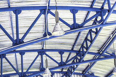 Lamp and blue ceiling structure Stock Image