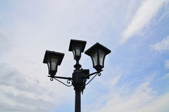 Lamp with blue sky. Background in the garden Royalty Free Stock Images