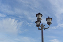 Lamp on blue sky with cloud Stock Photography
