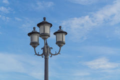 Lamp on blue sky with cloud Stock Photo