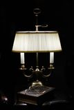 Lamp & Book. Bronze table lamp with white shade, 'Gone with the Wind' book and glasses (focused on the lamp Stock Photos