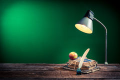 Lamp Books And Apple In The Classroom On Blackboard Background Royalty Free Stock Images