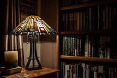 Lamp and Bookshelves. A cozy corner in which for discover, or rediscover, a favorite book Royalty Free Stock Photos
