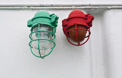 Lamp bracket at the wall. Warning lamps green and red on the wall Stock Photo