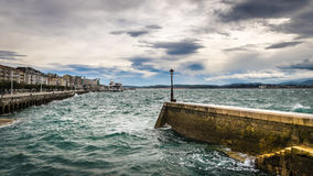 A lamp on the breakwater Stock Photos