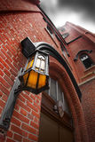 Lamp on red Brick Wall Stock Photography