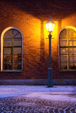 Lamp and brick wall. Standalone Lamp and brick wall in twilight Royalty Free Stock Image