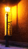 Lamp and brick wall. Standalone Lamp and brick wall in twilight Stock Photos
