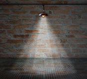 Lamp at brick wall background with glass floor Royalty Free Stock Photo