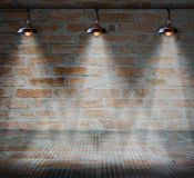 Lamp at brick wall background with glass floor Stock Image