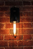 Lamp on a brick wall stock image