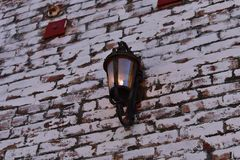 Lamp on a brick wall royalty free stock photo