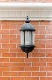 Lamp on brick wall Stock Photo