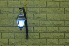 The lamp on a brick wall on the left. Background with a lamp on a brick wall on the left stock photos
