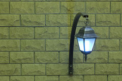 The lamp on a brick wall on the right. Background with a lamp on a brick wall on the right royalty free stock image