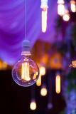 Lamp bulb. On a purple background Royalty Free Stock Photos