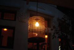 Lamp in cage. Unique traditional lampshade like cage Stock Photography