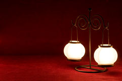 Lamp on carmine background. Lamp with two balls and iron stand on red carmine background Royalty Free Stock Images