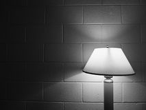Lamp Casting Shadow. A lamp casting a shadow on a brick wall in black and white stock photography
