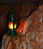 Lamp on a cave wall Stock Images