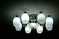 Lamp on the ceiling. Ceiling lamp turned on in folk house stock photos