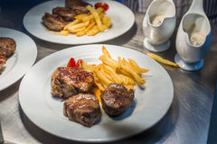 Lamp chop with french fries and tomatoes royalty free stock photography