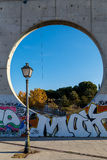 Lamp and circular window in an urban sculpture in Madrid, Spain Stock Image