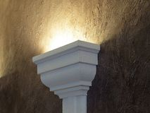 Lamp on a claret wall. Royalty Free Stock Photo