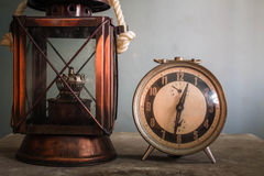 Lamp and clock on table. Royalty Free Stock Photography