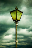 Lamp and clouds Stock Photos